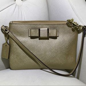 Coach gold saffiano Leather Darcy Bow wristlet